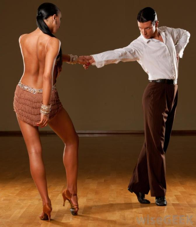 man-and-woman-dancing-on-wood-floor